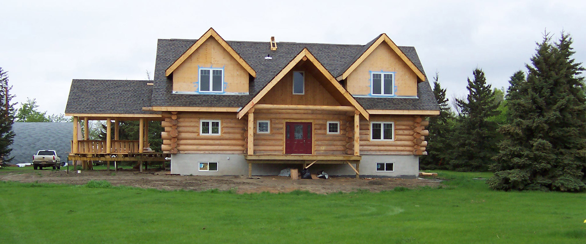 Acadian Log Homes
